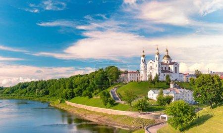 Panorama of beautiful old orthodox church belfry in Vitebsk, Belarus, Europe. Blue cloudy sky in background.