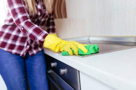 Photo for Woman cleaning house with microfiber cloth - Royalty Free Image