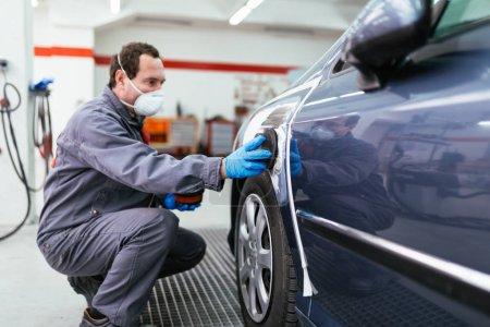 Car detailing - Man preparing car for painting procedure