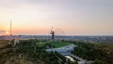 Russia, Volgograd - August 28, 2017: In light of setting sun. Sculpture Motherland Calls! - compositional center of  monument-ensemble to  Heroes of  Battle of Stalingrad on Mamayev Kurgan