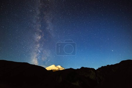 Photo for Stars and clouds over Mount Elbrus. Night landscape. Russia - Royalty Free Image