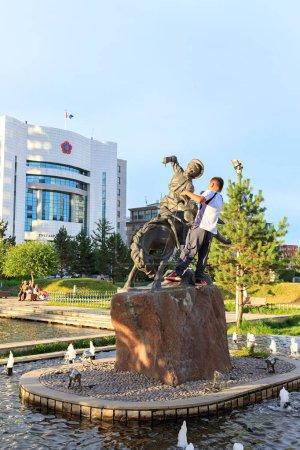 Mongolia, Ulaanbaatar - August 08, 2018: A boy on a horse. Sculptures in Ulaanbaatar Public Garden