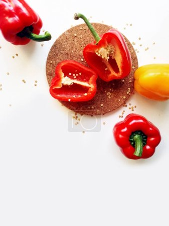 Red and yellow bell peppers isolated on a white background, top view with copy space