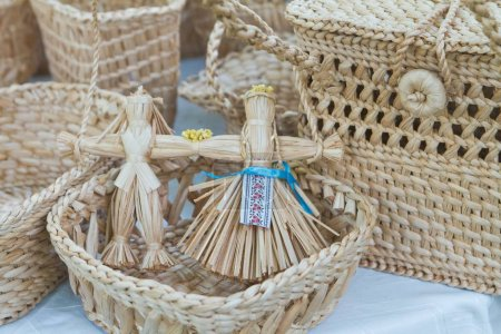 handmade folklore figure toys in straw basket, plaiting, embroidered ribbon, craft art