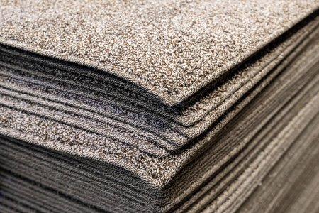 Stack gray bath mats bath mats Stack, stacked on top of each other. Terry mats.