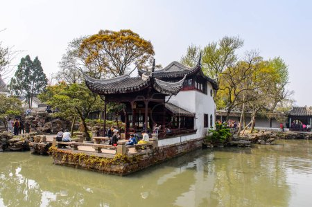 Photo for SUZHOU, CHINA - APR 1, 2016: Pagoda at the  The Humble Administrator's Garden,  a Chinese garden in Suzhou, a UNESCO World Heritage Site - Royalty Free Image