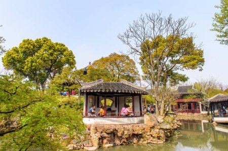 Photo for SUZHOU, CHINA - APR 1, 2016: Unidentified tourists at the The Humble Administrator's Garden,  a Chinese garden in Suzhou, a UNESCO World Heritage Site - Royalty Free Image