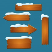 Set of shabby wooden signs isolated on a blue background Horizontal vertical and arrow shaped planks with ragged edges covered with snow Vector elements