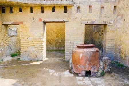 Herculaneum, ancient Roman town. wine warhouse with big amphora, Ercolano, Italy