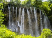 beautiful waterfall at a lagoon with clear lake