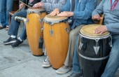 Mexican street artists playing drums in a row during a performance