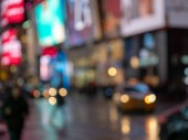 Intentionally defocused dream-like scene of a busy night in Times Square, NYC