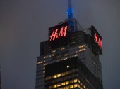 NEW YORK, NY  MAY 16, 2018- 4 Times Square building with H&M sign looming high on a rainy day