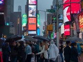 NEW YORK, NY  MAY 16, 2018- Tourists exploring Times Square while dodging rain