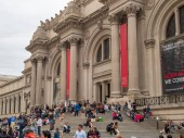 NEW YORK, NY  MAY 18, 2018- Museum goers and tourists rest outside on the steps of the The Met (The Metropolitan Museum of Art).