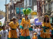 SAN FRANCISCO, CA  MAY 27, 2018- Woman on stilts and Mexican festive wear walks down the street at the Carnaval festival