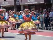 SAN FRANCISCO, CA  MAY 27, 2018- Women showing off spin dance moves wearing Mexican fiesta dresses marching down the SF Caranval parade