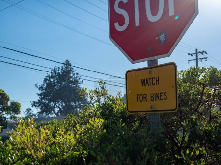 Photo for Large stop sign with a notice for watch for bikes on sign - Royalty Free Image