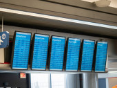 American Airlines departures and arrivals screens at airport