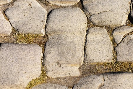 Ancient stone road with cobblestone in the ancient...