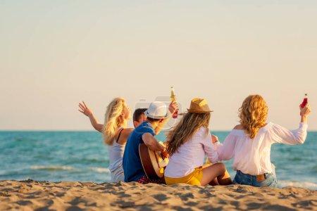 Group of friends enjoy on the beach...