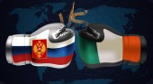 Boxing gloves with prints of Irish and Russian flags facing each other on a boxing ring background vector illustration