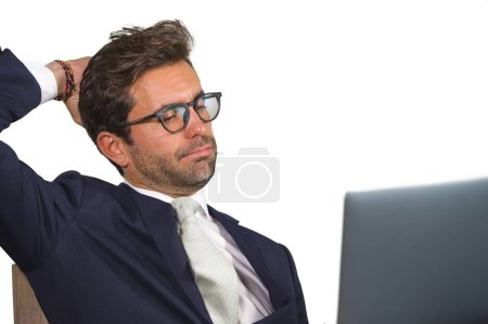 Photo for Company corporate isolated close up portrait of young handsome and attractive businessman in business suit and glasses working at office confident  in finance success and executive lifestyle - Royalty Free Image
