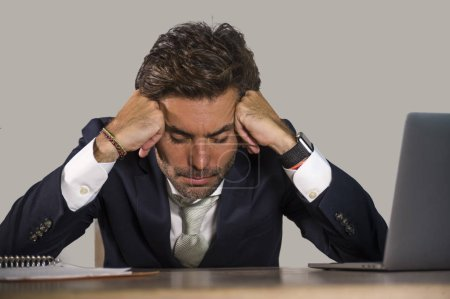 Photo for Young desperate and stressed businessman feeling depressed and overwhelmed working at office computer desk tired and exhausted  defeated by business financial crisis problem - Royalty Free Image