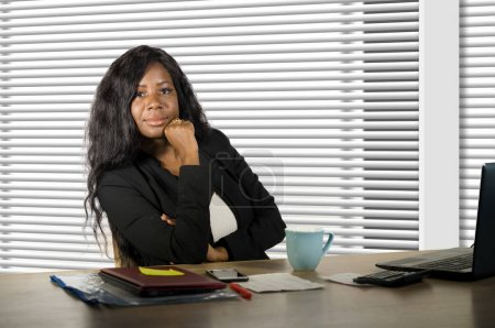 Photo for Corporate business portrait of young beautiful and confident black African American businesswoman working at office computer desk looking bossy and relaxed in woman job success - Royalty Free Image