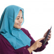 Young Asian businesswoman wearing suit and hijab w...