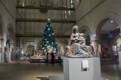 NEW YORK, NEW YORK/USA - December 17, 2018: Medieval Sculpture Hall during Christmas located inside Metropolitan Museum of Art on 5th avenue Manhattan. Virgin with child by artist Claus De Werve figure in front.