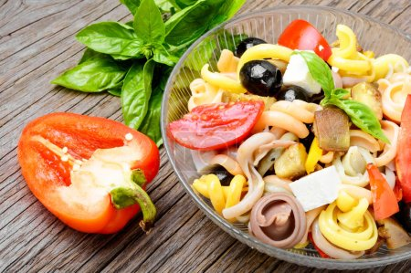 Photo for Italian salad with pasta and fried vegetables.Italian Cuisine - Royalty Free Image
