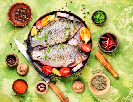 Photo for Fish with herbs, spices and vegetables - healthy food.Dietary food - Royalty Free Image