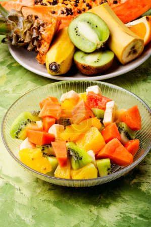 Photo for Delicious fruits salad in plate on table - Royalty Free Image
