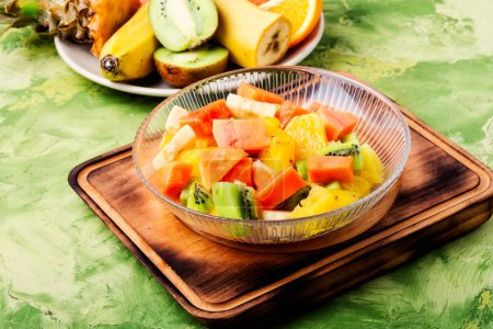 Photo for Fresh fruit salad on gray stone table.Colorful fruit salad - Royalty Free Image