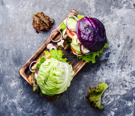 Photo for Veggies burgers served on cutting board.Vegan food concept - Royalty Free Image