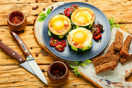 Photo for Fried eggs with tomatoes in plate on rustic wooden table.Fried eggs for healthy breakfast - Royalty Free Image