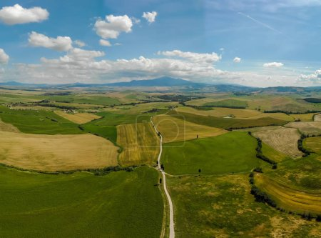 Gladiator Road with cypress trees in the Val d orcia (Orcia Valley) towards Terrapille - near Pienza in Tuscany, Italy - cypress trees along the famous white road, or strada bianca - Aerial view