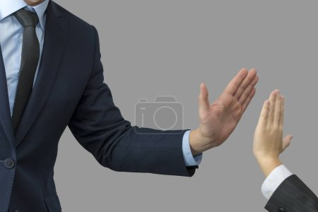 father and son in formal wear giving high five.