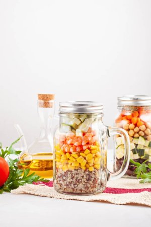 Photo for Fresh homemade salad in jars with quinoa, chickpeas  and organic vegetables. Healthy take away food, office lunch, vegeterian, detox diet concept. - Royalty Free Image