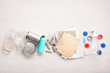 Photo for Flat lay of different wastes wastes ready for recycling. Plastic, glass, paper, tin cans. Social responsibility, ecology care concept - Royalty Free Image