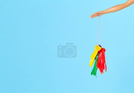 Photo for Doll hand with popped balloons. Disappointment and ruined illusion concept - Royalty Free Image