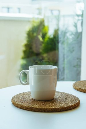 Photo for Cup of coffee on white table - Royalty Free Image