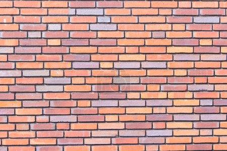 Photo pour Texture de fond de mur de briques gros plan, briques colorées - image libre de droit
