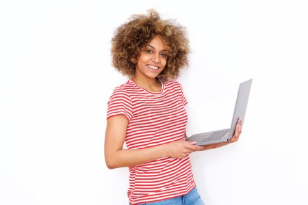 Photo for Portrait of beautiful young african american woman holding laptop against white background - Royalty Free Image
