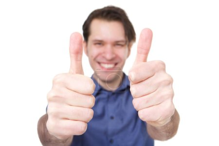 Photo for Close up portrait of smiling man holding two thumbs up - Royalty Free Image