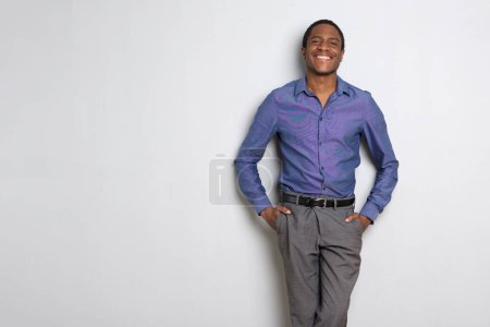 Portrait of african american businessman smiling against white background