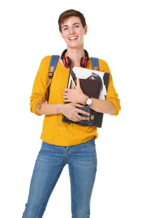 Photo for Portrait of smiling female college student with bag and books against isolated white background - Royalty Free Image