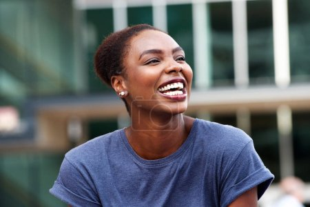 Photo for Close up portrait of attractive young african american woman laughing outdoors - Royalty Free Image