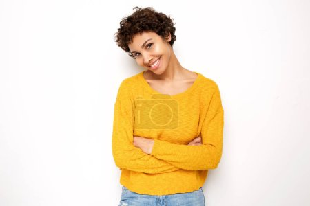 Photo for Portrait of smiling young woman standing by white background with arms crossed - Royalty Free Image